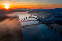 In this aerial image, the sun rises high atop the horizon, painting a colorful backdrop over the 360 Pennybacker Bridge over Lake Austin with the Austin skyline in the background. I wish painter Bob Ross were here to see this and paint this iconic scene.