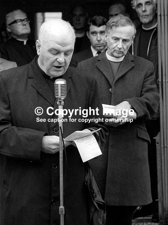 There was a good turn-out despite the rain for a Prayers for Peace event in Armagh, N Ireland, 1st October 1972 led by Irish church leaders. Leading the prayers at the microphone is Cardinal William Conway, head of the Roman Catholic Chuch in Ireland. Beside him is Archbishop George Otto Simms, the Church of Ireland Primate of All Ireland. 197210010604b<br />
