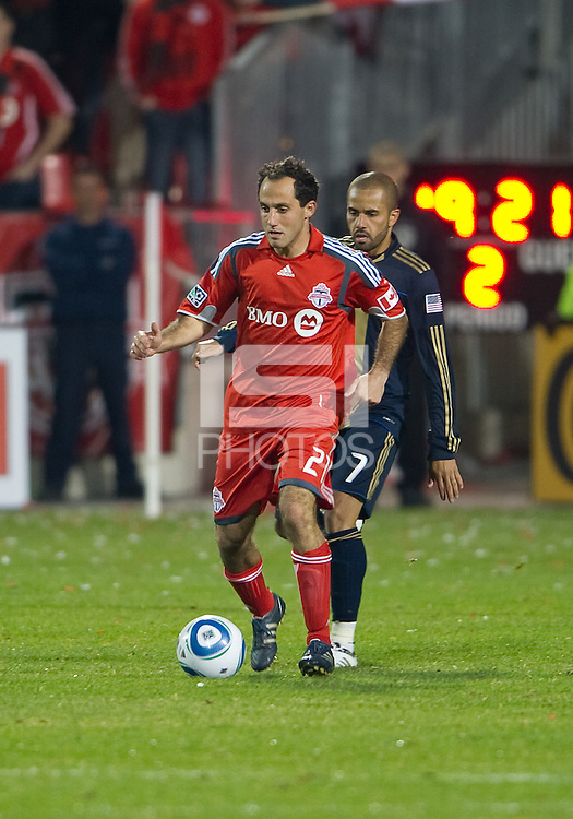 15 April 2010: Toronto FC midfielder Nick LaBrocca #21 and Philadelphia Union midfielder Fred #7 in action during a game between the Philadelphia Union and Toronto FC at BMO Field in Toronto..Toronto FC won 2-1..Photo by Nick Turchiaro/isiphotos.com.