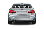Straight rear view of 2017 BMW 3-Series 320i 4 Door Sedan Rear View  stock images