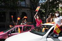 MADRID, SPAIN - MAY 23: Protesters wave Spanish flags from their cars during the demonstration organized by VOX, Spanish far-right party and third biggest party in the Parliament, to demand the resign of the national Government on 23 May 2020, in Madrid, Spain. This protest, which should be participated from the car, occurs in the middle of deescalation plans of covid 19 and the state of emergency remains active due to the coronavirus. (Photo by Sergio Belena / VIEWpress).