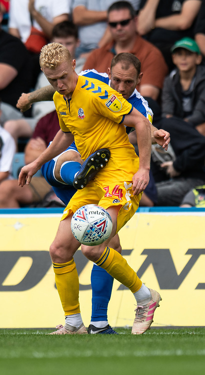 Gillingham's Barry Fuller (right) battles with Bolton Wanderers' James Weir (left) <br /> <br /> Photographer David Horton/CameraSport<br /> <br /> The EFL Sky Bet League One - Gillingham v Bolton Wanderers - Saturday 31st August 2019 - Priestfield Stadium - Gillingham<br /> <br /> World Copyright © 2019 CameraSport. All rights reserved. 43 Linden Ave. Countesthorpe. Leicester. England. LE8 5PG - Tel: +44 (0) 116 277 4147 - admin@camerasport.com - www.camerasport.com