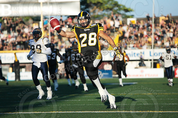 Aug 3, 2007; Hamilton, ON, CAN; Hamilton Tiger-Cats running back (28) Jesse Lumsden scores a touchdown against the Winnipeg Blue Bombers during the first quarter at Ivor Wynne Stadium. Mandatory Credit: Ron Scheffler