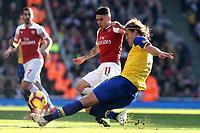 Lucas Torreira of Arsenal and Jannik Vestergaard of Southampton during Arsenal vs Southampton, Premier League Football at the Emirates Stadium on 24th February 2019