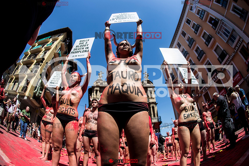 Pro-animal rights activists hold placards after spreading red powder on themselves and breaking fake 'banderillas' (spears to jab the bull) to protest against bullfighting and bull-running during a demonstration called by the People for the Ethical Treatment of Animals (PETA) and Anima Naturalis pro-animal groups on the eve of the San Fermin festivities in the Northern Spanish city of Pamplona on July 5, 2017.(ALTERPHOTOS/Rodrigo Jimenez) /NortePhoto.com