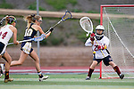 San Diego, CA 04/19/10 - Victoria Ransom (La Costa Canyon #20) and Carrie Yang (Torrey Pines #20) in action during the Torrey Pines-La Costa Canyon Girls Lacrosse game at Torrey Pines.