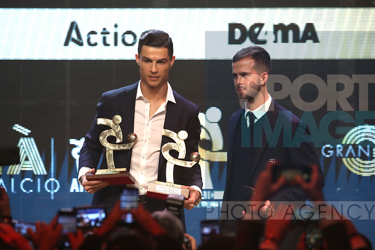 Cristiano Ronaldo of Juventus with a The player of the Year award for 2019 and a best Striker award pictured with team mate Miralem Pjanic and his best midfielder award at the The Italian Footballers Association Grand Gala of Football at the Megawatt Court, Milan. Picture date: 2nd December 2019. Picture credit should read: Jonathan Moscrop/Sportimage