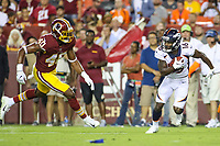 Landover, MD - August 24, 2018: Denver Broncos wide receiver Isaiah McKenzie (16) avoids Washington Redskins linebacker Josh Harvey-Clemons (40) during the preseason game between Denver Broncos and Washington Redskins at FedEx Field in Landover, MD.   (Photo by Elliott Brown/Media Images International)