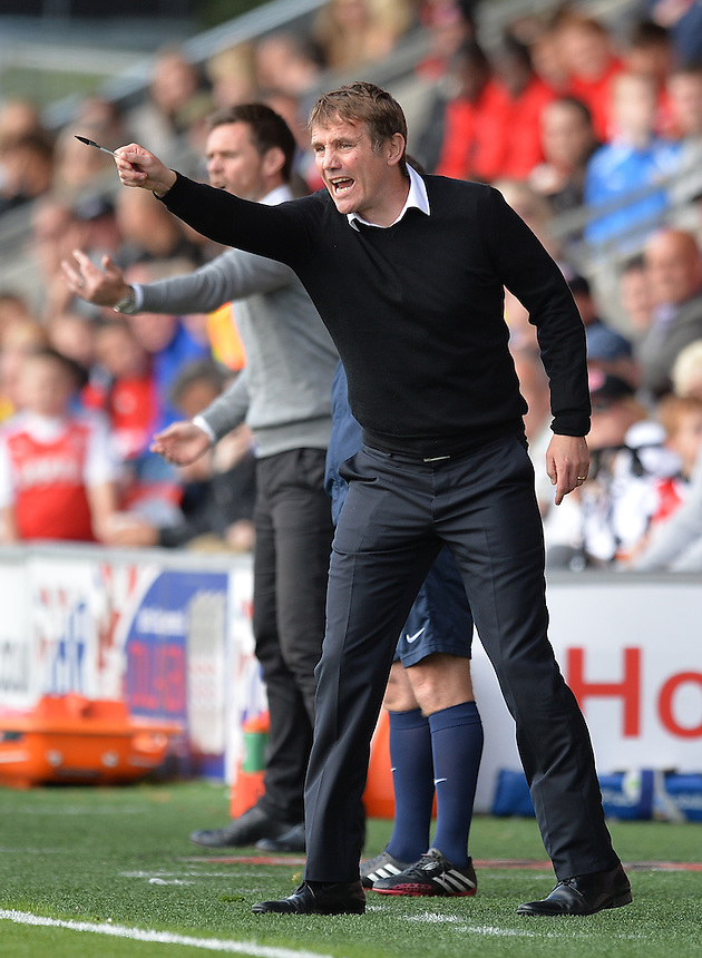 Bradford City's Manager Phil Parkinson shouts instructions to his team from the dug-out<br /> <br /> Photographer Dave Howarth/CameraSport<br /> <br /> Football - The Football League Sky Bet League One -  Fleetwood Town v Bradford City - Saturday 12th September 2015 -  Highbury Stadium - Fleetwood <br /> <br /> &copy; CameraSport - 43 Linden Ave. Countesthorpe. Leicester. England. LE8 5PG - Tel: +44 (0) 116 277 4147 - admin@camerasport.com - www.camerasport.com
