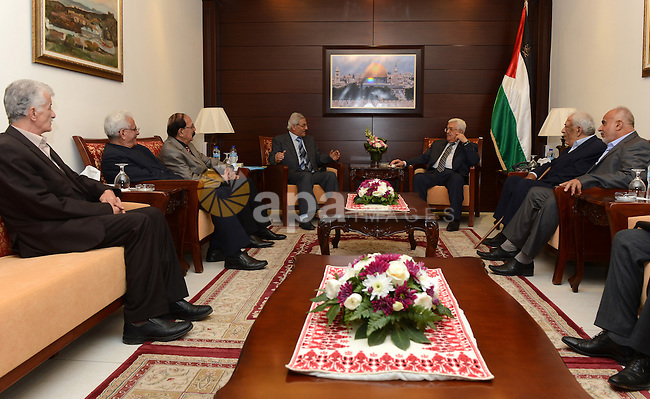 Palestinian President, Mahmoud Abbas during meets with a delegation from the Arab Liberation Front in the West Bank city of Ramallah on April 26, 2015. Photo by Osama Falah