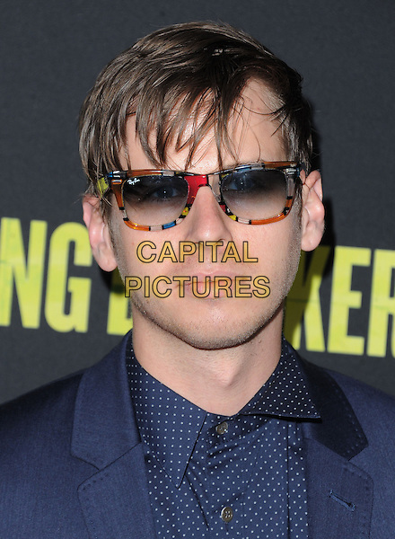 Mark Foster.at the Los Angeles Premiere of 'Spring Breakers' held at The Arclight Theater in Hollywood, California, USA, .March 14th 2013.                                                                    .portrait headshot sunglasses ray bans blue navy shirt fringe messy hair polka dot white print red multi-coloured frames wayfarers .CAP/DVS.©Debbie VanStory/Capital Pictures.