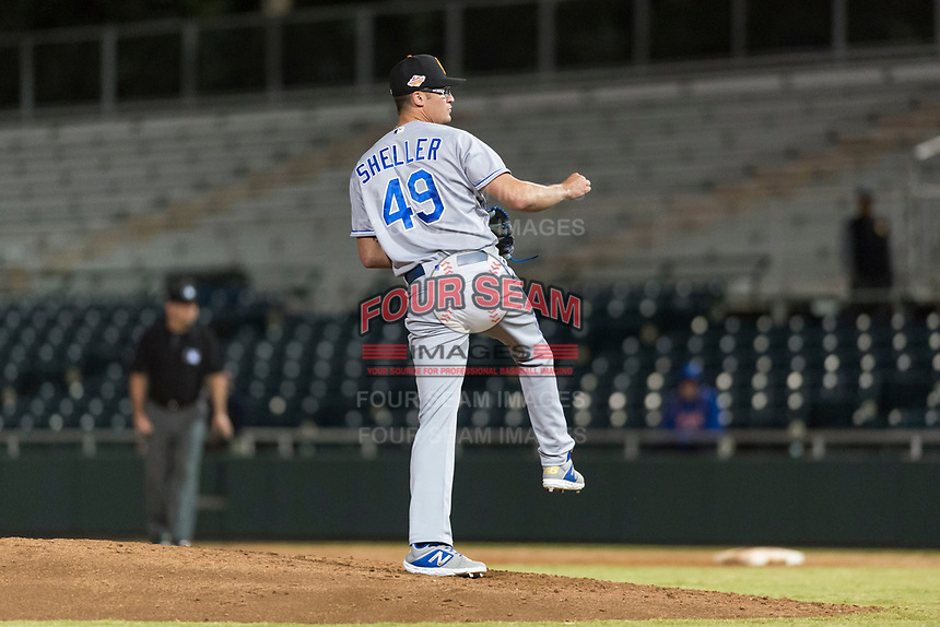 Surprise Saguaros relief pitcher Walker Sheller (49), of the Kansas City Royals, follows through on his delivery during an Arizona Fall League game against the Scottsdale Scorpions at Scottsdale Stadium on October 15, 2018 in Scottsdale, Arizona. Surprise defeated Scottsdale 2-0. (Zachary Lucy/Four Seam Images)