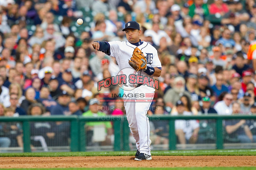 Detroit Tigers third baseman Miguel Cabrera (24) makes a throw to first base against the Tampa Bay Rays at Comerica Park on June 4, 2013 in Detroit, Michigan.  The Tigers defeated the Rays 10-1.  Brian Westerholt/Four Seam Images