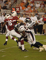 Aug. 31, 2006; Glendale, AZ, USA; Arizona Cardinals quarterback (16) John Navarre gets sacked by Denver Broncos linebacker (54) Patrick Chukwurah at Cardinals Stadium in Glendale, AZ. Mandatory Credit: Mark J. Rebilas