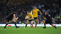 Drew Mitchell of Australia faces up to Samuel Whitelock and Owen Franks of New Zealand during the Rugby World Cup Final between New Zealand and Australia - 31/10/2015 - Twickenham Stadium, London<br /> Mandatory Credit: Rob Munro/Stewart Communications