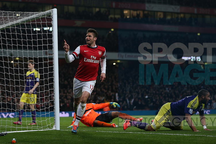 Arsenal's Olivier Giroud celebrates scoring his sides second goal<br /> <br /> Arsenal vs Swansea City - Premier League - Emirates Stadium- London - England - 25/03/2014  - Pic David Klein/Sportimage