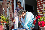 Karen Morris has been caring for her mother Gloria, 80, for the past 10 years. Her mother has Alzheimer's disease and lives with Karen and Karen's husband Richard in their Charlotte, NC home. The pair take in the morning sunshine on the front porch. ..Mrs. Morris was a nurse before she retired and really enjoys taking care of people, she said. Every morning she washes her mother in the bathroom, helps her walk down the stairs, and they share breakfast, as they did Monday, October 18, 2010...Gloria was having an especially bad day and because Karen sees her every day, she knew something was wrong. She later discovered her medication was dehydrating her. That is one of many reasons why having a regular caretaker is so important. . ...Kendrick Brinson.LUCEO.Model Released: Yes.AARP Contract #4859.Wichita/Bellovin Bulletin