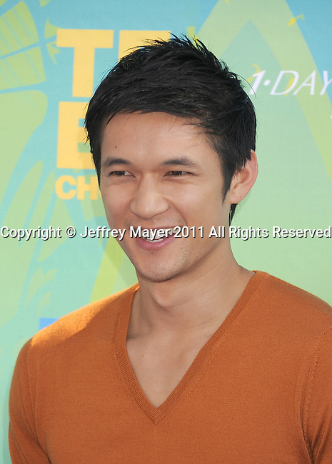 UNIVERSAL CITY, CA - AUGUST 07: Harry Shum, Jr. arrives at the 2011 Teen Choice Awards held at the Gibson Amphitheatre on August 7, 2011 in Universal City, California.