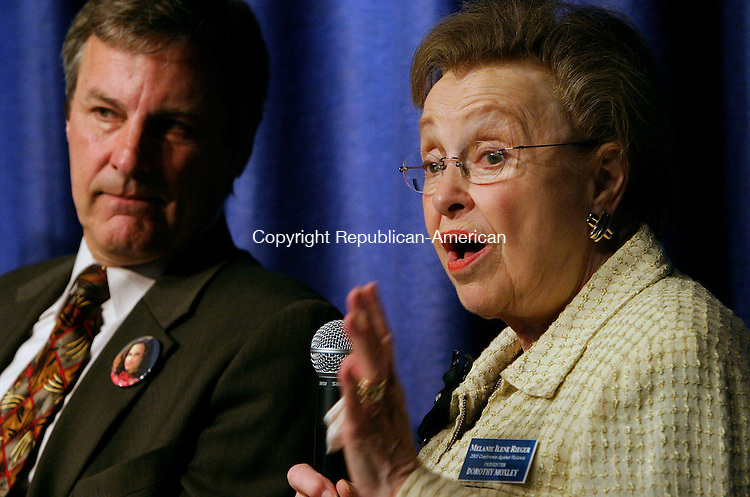 CHESHIRE, CT - 21 APRIL 2005 - 042105JS05--Dorothy Moxley, mother of Martha Moxley, right, talks to the audience while Marc Klass, left, father of Polly Klass listens, during the ninth annual Melanie Ilene Rieger Conference Against Violence Thursday at the state Department of Correction's Maloney Center for Training &amp; Staff Development in Cheshire. <br /> --Jim Shannon Photo --Department of Correction's Maloney Center for Training &amp; Staff Development; Cheshire; Christopher Morano; Rieger Conference Against Violence, Polly Klass, Marc Klass, Martha Moxley, Dorothy Moxley are CQ