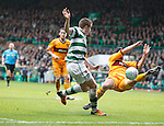 Celtic's James Forrest appeals for a handball as MOtherwell defender Tim Clancy knocks down the ball in the box from his cross