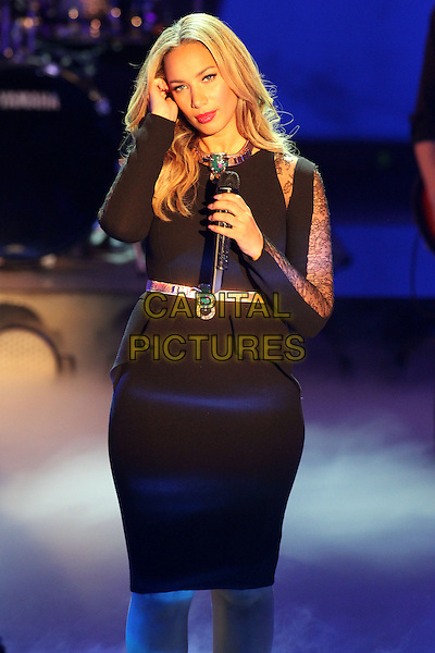 "Leona Lewis.Germany's biggest live TV-show ""Wetten Dass"", Offenburg, Germany..January 19th, 2013.half length black dress lace peplum gold belt on stage in concert live gig performance performing music hand arm.CAP/UNT.©Unit2/Capital Pictures"