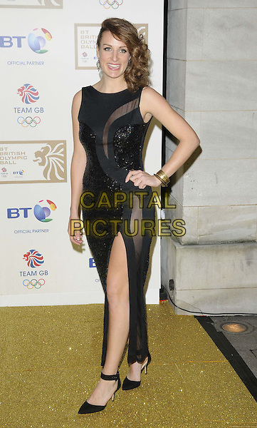 Ashleigh Ball.attended the BT British Olympic Ball, Grosvenor House Hotel, Park Lane, London, England, 30th November 2012..full length black sheer dress long maxi slit split sequined sequin mesh side hand on hip sleeveless .CAP/CAN.©Can Nguyen/Capital Pictures.