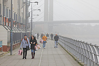 Pictured: Walkers by river Usk in Newport, Wales, UK. Thursday 14 February 209<br /> Re: The city of Newport is preparing to host the FA Cup match between Newport County and Manchester City at Rodney Parade, Newport, Wales, UK.