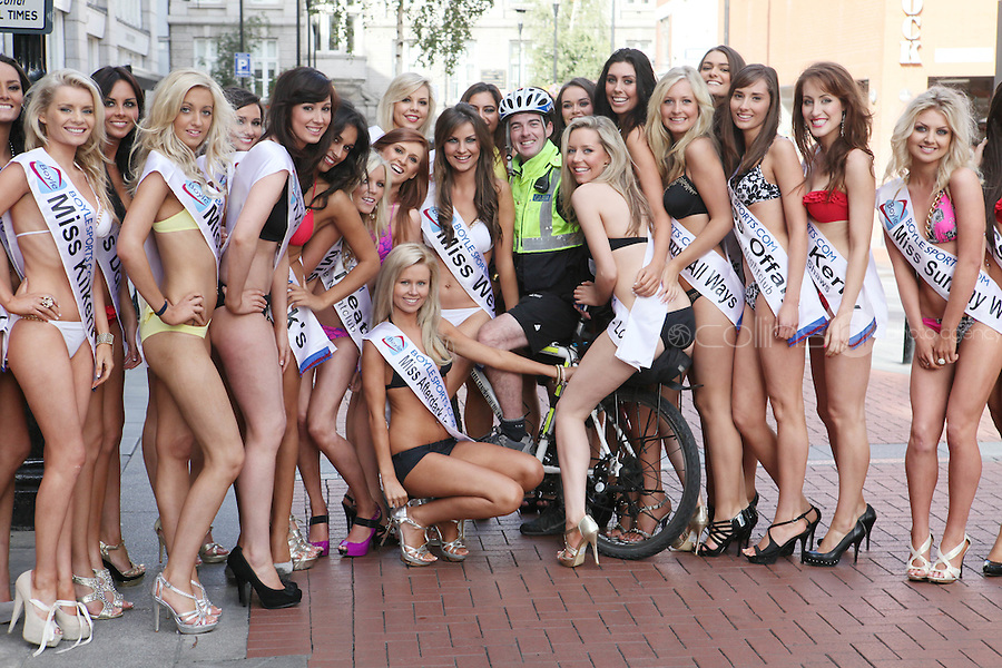17/9/2010. Miss Ireland contestants. Garda Adian O Connor is pictured meeting the 35 Miss Ireland contestants as they officially unveiled in their swimwear and sashes for the 1st time at Stephen's Green Shopping Centre,  Dublin. Picture James Horan/Collins Photos