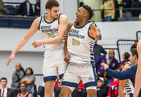 WASHINGTON, DC - JANUARY 29: Jamison Battle #10 and Ace Stallings #20 of George Washington celebrate a four overtime GW win during a game between Davidson and George Wshington at Charles E Smith Center on January 29, 2020 in Washington, DC.