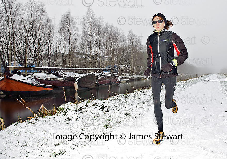 FIONA MATHESON FROM FALKIRK GOES OUT TRAINING ALONG THE BANKS OF THE FORTH AND CLYDE CANAL DESPITE THE OVERNIGHT SNOW FALL.