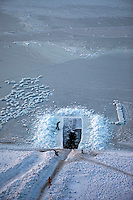 A woman runs after getting out of an outdoor swimming pool made out of a hole in the ice near the port of Vladivostok.