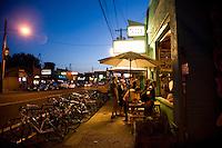 Diners enjoy a warm summer night at the trendy Por Que No Taqueria in Portland Oregon