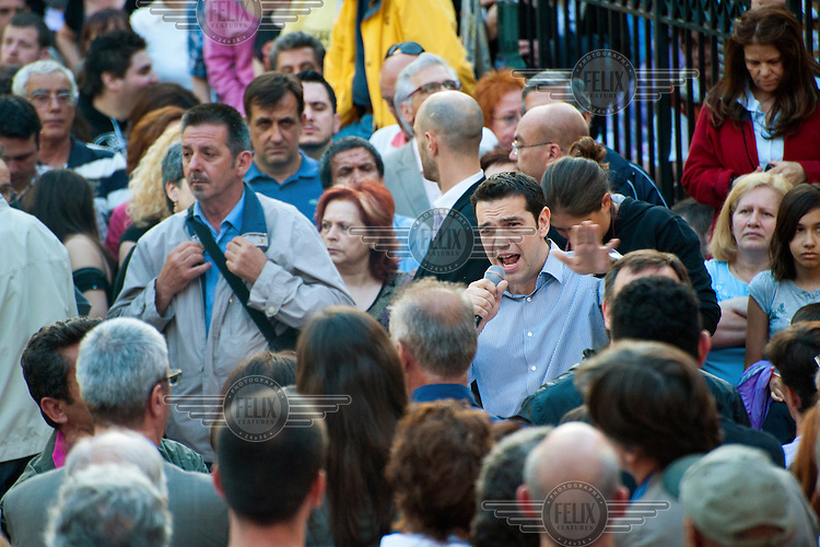 Opposition party Synasmispos president Alexis Tsipras gives a speech at the Assembly of SYRIZA (the Coalition of the Radical Left parliamentary group, of which he is the head) in Aghia Ekaterini Square, in the Kato Petralona neighbourhood  of Athens.
