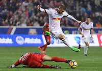 Harrison, NJ - Thursday March 01, 2018: German Mejía, Daniel Royer. The New York Red Bulls defeated C.D. Olimpia 2-0 (3-1 on aggregate) during a 2018 CONCACAF Champions League Round of 16 match at Red Bull Arena.