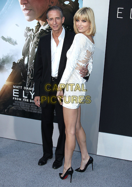 Bill Block, Eugenia Kuzmina<br /> &quot;Elysium&quot; Los Angeles Premiere held at the Regency Village Theatre, Westwood, California, UK,<br /> 7th August 2013.<br /> full length dress velvet v-neck long sleeve white hand on hip black suit shirt <br /> CAP/ADM/RE<br /> &copy;Russ Elliot/AdMedia/Capital Pictures