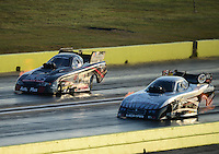 Sept. 21, 2012; Ennis, TX, USA: NHRA funny car driver Jack Beckman (near lane) races alongside Blake Alexander during qualifying for the Fall Nationals at the Texas Motorplex. Mandatory Credit: Mark J. Rebilas-US PRESSWIRE