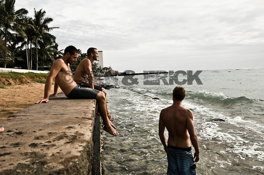 Brendon Backshall, Jason Finlay and Joe Clark in Waikiki on Oahu in Hawaii