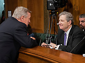 United States Senator Dick Durbin (Republican of Illinois), left, and US Senator John Kennedy (Republican of Louisiana), right, converse prior to the US Senate Committee on the Judiciary holding a vote on the nomination of Judge Brett Kavanaugh to be Associate Justice of the US Supreme Court to replace the retiring Justice Anthony Kennedy on Capitol Hill in Washington, DC on Friday, September 28, 2018.  If the committee votes in favor of Judge Kavanaugh then it goes to the full US Senate for a final vote.<br /> Credit: Ron Sachs / CNP<br /> (RESTRICTION: NO New York or New Jersey Newspapers or newspapers within a 75 mile radius of New York City)