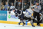 SIOUX FALLS, SD - MAY 5:  Ian Mansfield #8 from the Sioux Falls Stampede and Gage Torrel #25 from the Fargo Force get tangled up going for a loose puck in the first period during their game Sunday night at the Sioux Falls Arena. (Photo by Dave Eggen/Inertia)