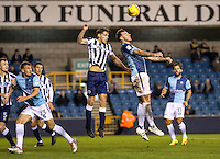 Max Muller of Wycombe Wanderers and Sid Nelson of Millwall during the Checkatrade Trophy round two Southern Section match between Millwall and Wycombe Wanderers at The Den, London, England on the 7th December 2016. Photo by Liam McAvoy.