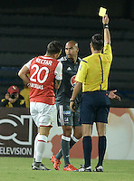 BOGOTÁ -COLOMBIA, 07-02-2016. Nicolas Gallo, arbitro, muestra la tarjeta amarilla a Lewis Ochoa de Millonarios durante partido entre Independiente Santa Fe y Millonarios por la fecha 3 de la Liga Aguila I 2016 jugado en el estadio Nemesio Camacho El Campin de la ciudad de Bogota. / Nicolas Gallo, referee, swows the yellow card to Lewis Ochoa of Millonarios during a match between Independiente Santa Fe and Millonarios for the date 3 of the Liga Aguila I 2016 played at the Nemesio Camacho El Campin Stadium in Bogota city. Photo: VizzorImage/ Gabriel Aponte / Staff