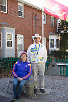 Carlos Arredondo, 57, (right) and his wife Melida Arredondo, 52, are seen in their front yard in Roslindale, Boston, Massachusetts, USA, on Sat., March 31, 2018. Arredondo is well known as the &quot;man in the cowboy hat&quot; who helped out in the aftermath of the Boston Marathon Bombing in 2013. Carlos is wearing a jacket that he has used to create a t-shirt design for when he runs the Boston Marathon later this year. Though he has run the race unofficially previously, this will be the first time he runs it &quot;legally,&quot; he says.<br /> <br /> Behind the couple is a memorial to their two sons,  Marine Lance Corporal Alexander Scott Arredondo and Brian Arredondo. Alex was killed while serving in Iraq in 2004, and Brian died by suicide in 2011.