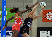 Bailey Mes takes a pass under pressure from Ama Agbeze during the Taini Jamieson Trophy Series netball match between the New Zealand Silver Ferns and England Roses at Te Rauparaha Arena in Porirua, New Zealand on Wednesday, 7 September 2017. Photo: Dave Lintott / lintottphoto.co.nz