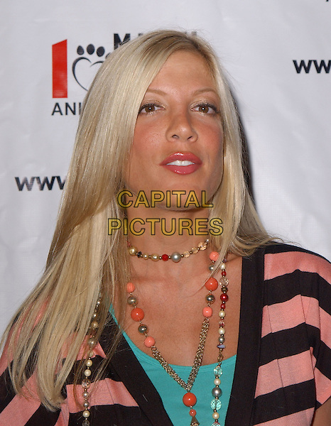 TORI SPELLING .The 3rd Annual Much Love Animal Rescue Celebrity Comedy Benefit held at The Laugh Factory in Hollywood, California .September 29, 2004.headshot, portrait, beaded necklace.www.capitalpictures.com.sales@capitalpictures.com. Copyright 2004 by Debbie VanStory