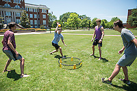 Students enjoy a game of spikeball and sunny weather on the Drill Field. From left, Phillip Keck, a junior chemistry major from Brandon; Trevor Sanford, a senior music major from Irondale, Alabama; Matt Mlsna, a junior chemistry major from Starkville; and Jake Mlsna, a freshman finance major from Starkville, all try to master the game.<br />  (photo by Sarah Dutton / &copy; Mississippi State University)