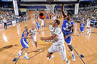 25 February 2010:  FIU's Tremayne Russell (3) attempts to put up a shot as MTSU's Desmond Yates (31) defends in the second half as the Middle Tennessee Blue Raiders defeated the FIU Golden Panthers, 74-71, at the U.S. Century Bank Arena in Miami, Florida.