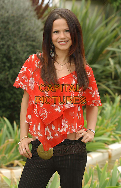 "TAMMIN SURSOK.(who plays Dani Sutherland).at Home and Away DVD launch of.""Secrets and the City"" .at Kensington Roof Gardens.sales@capitalpictures.com.www.capitalpictures.com.©Capital Pictures.belt buckle, red floaty top with floral print.half length, half-length"