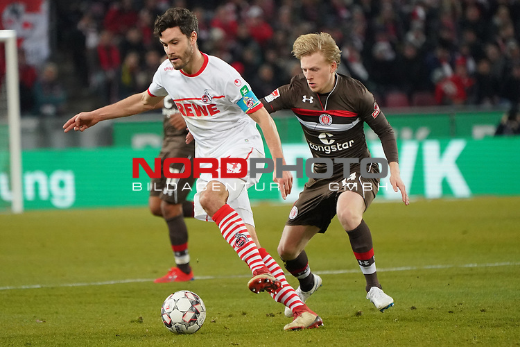 08.02.2019, RheinEnergieStadion, Koeln, GER, 2. FBL, 1.FC Koeln vs. FC St. Pauli,<br />  <br /> DFL regulations prohibit any use of photographs as image sequences and/or quasi-video<br /> <br /> im Bild / picture shows: <br /> Jonas Hector (FC Koeln #14),  im Zweikampf gegen  Mats M&ouml;ller / Moeller Daehli (St Pauli #14), <br /> <br /> Foto &copy; nordphoto / Meuter
