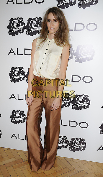 Jade Williams aka Sunday Girl .At the Aldo a/w 2011 collection party, One Marylebone, London, England, UK .21st June 2011..full length  brown silk satin wide leg trousers cream shirt sleeveless .CAP/CAN.©Can Nguyen/Capital Pictures.