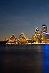 Views of the Opera House and the Harbour bridge in the evening at sunset from Dr. Mary Booth Walkway in North Sydney, NSW, Australia.